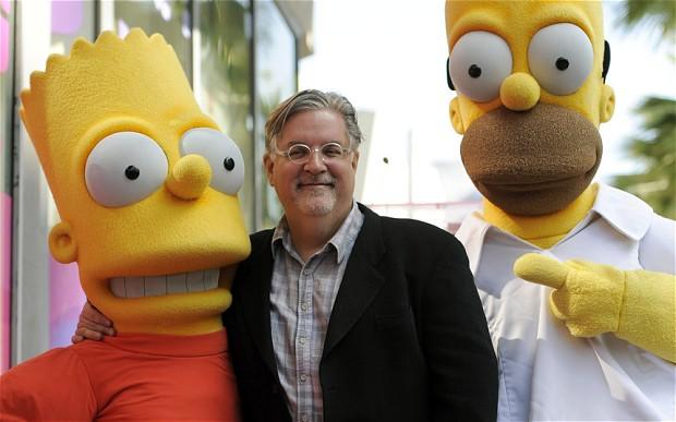 Matt Groening 與他創作的角色Bart Simpson及Homer Simpson